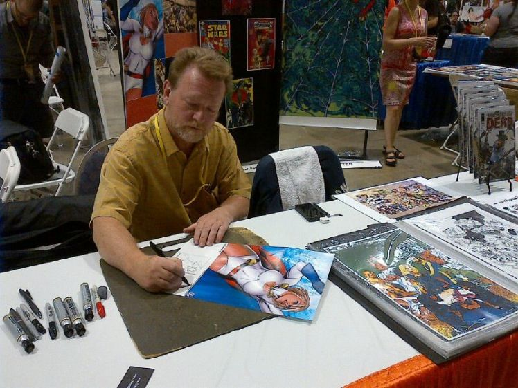 MIchael Golden signs one of his prints at ACE 13