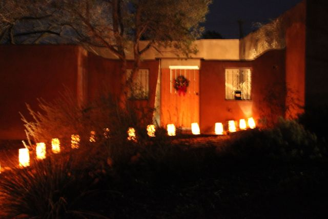 I think the luminarias leading up to the wreath on the gate door is so picturesque.