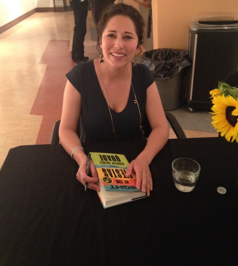 "Kirstin Valdez Quade signs ""Night at the Fiestas"" at A Word with Writers event sponsored by Bookworks to benefit the Albuquerque Public Library Foundation."